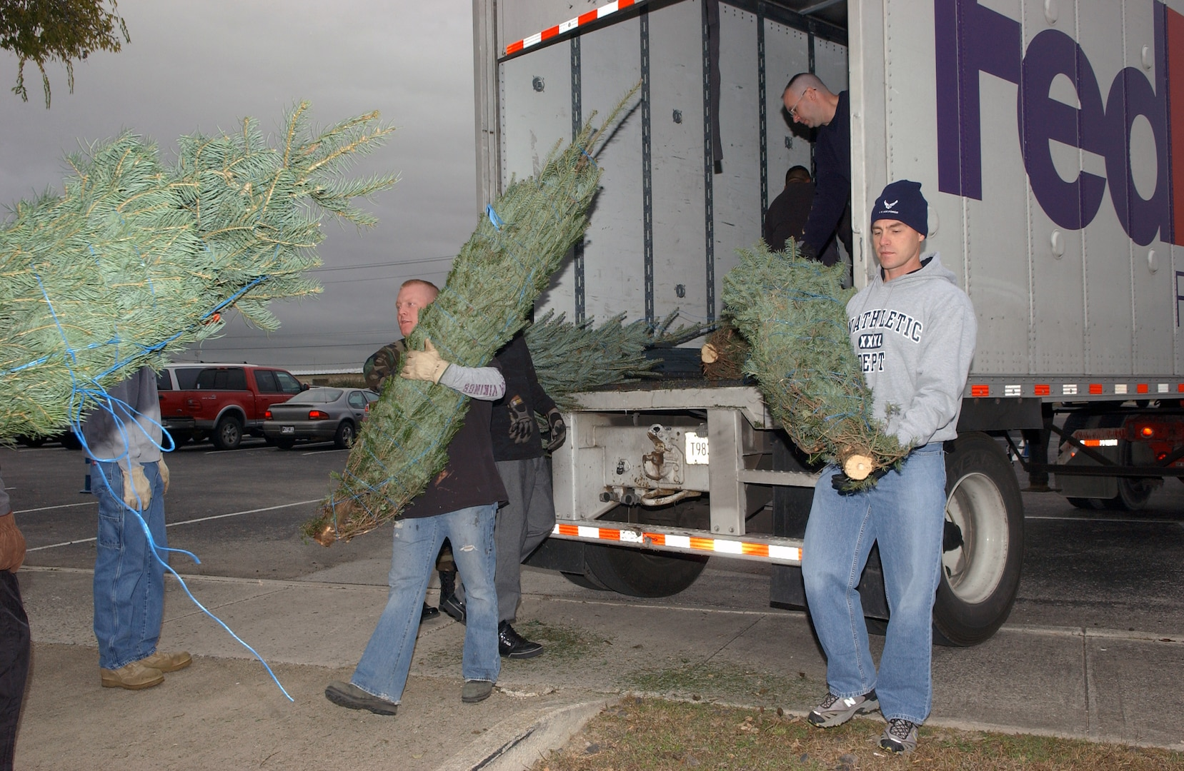 Volunteers from various squadrons on Lackland Air Force Base, Texas, unload a special delivery from FedEx on Dec. 6 - live Christmas trees. An additional 145 trees will be delivered Dec. 12. FedEx and the Christmas SPIRIT Foundation teamed together to provide approximately 20,000 trees to more than 30 military installations this year, including two in Texas, Fort Hood and Lackland AFB. (USAF photo by Alan Boedeker)