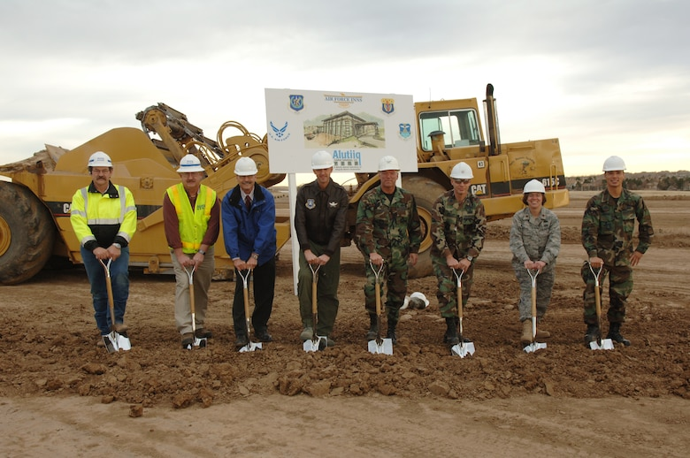 """BUCKLEY AIR FORCE BASE, Colo. -- Col. Bart Hedley, 460th Mission Support Group commander, Lt. Col. James Zemotel, 460th Civil Engineer Squadron commander, Maj. Teresa Darrow, 460th Services director, 1st Lt. Lionel Lanuza, 460th Civil Engineer Squadron, Col. Wayne McGee, 460th Space Wing commander and Bob Zulick, Tim Roberts and Leonard Gallippo of Alutiiq contracting break ground at the site of the visiting quarters/temporary living facility during a ceremony here Dec. 3. The project is the second largest for Buckley in recent years. Housing being the largest. The project includes 120 visitor's quarters and 30 temporary living facility units.   During the groundbreaking ceremony, Colonel McGee mentioned the fact that the project will support the base's mission and families during temporary duty and permanent change of station. He said the VQ/TLF will """"bring our community into the future.""""  The VQ/TLF is scheduled for completion in March 2009. (U.S. Air Force photo by Airman 1st Class Christopher Bush)"""