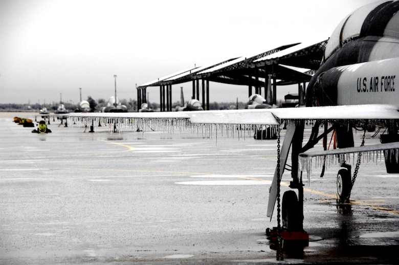 A T-38C Talon sits at Vance Air Force base as a mixture of precipitation coats surfaces across the state of Oklahoma. (U.S. Air Force photo by Terry Wasson)