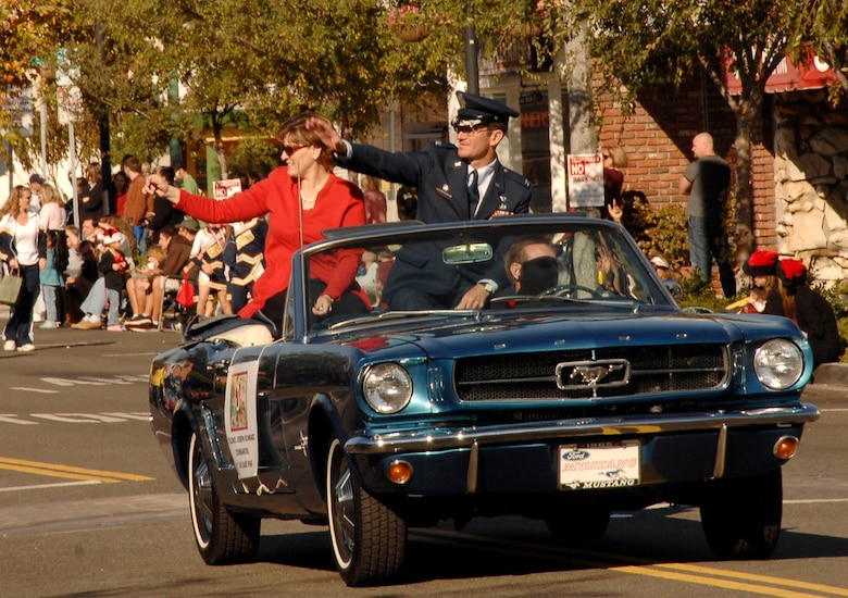 Col. Joseph Schwarz, 61st Air Base Wing commander, and his wife Holly represented the base in this year's El Segundo Holiday parade, Dec. 9. The Los Angeles Air Force Base Honor Guard kicked off the parade that featured community leaders and school groups. (Photo by Lou Hernandez)