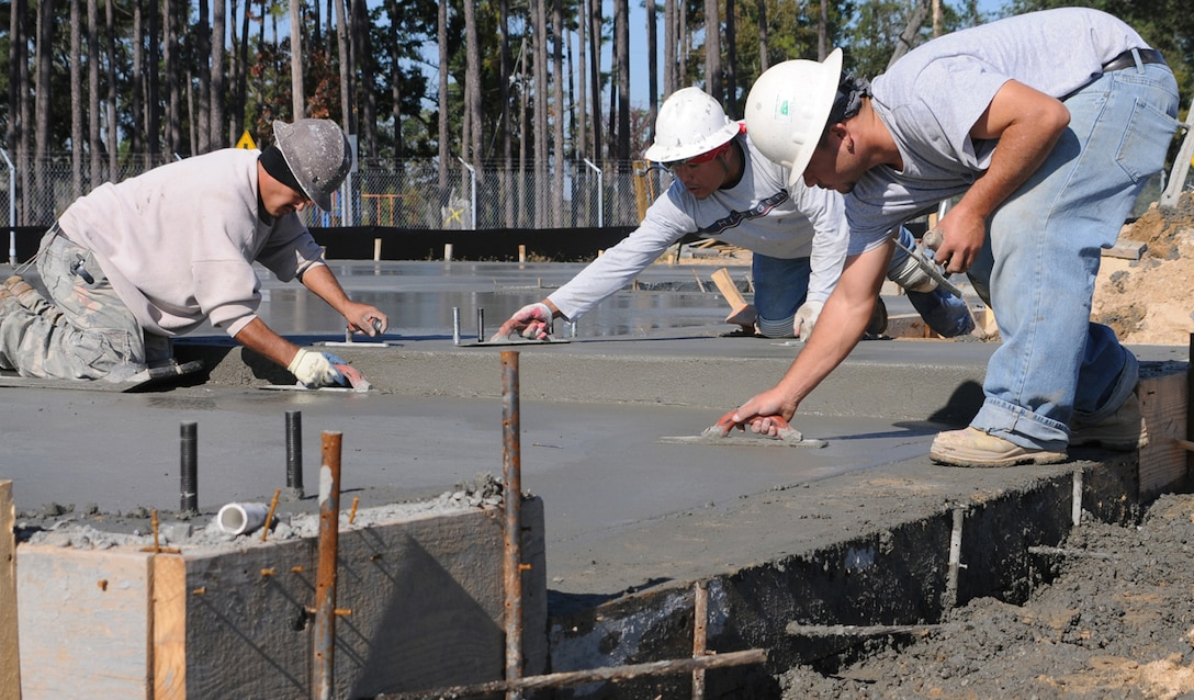 Concrete finishers Tobias Acostia, left, Alajondro Bonabadis and Octabio 