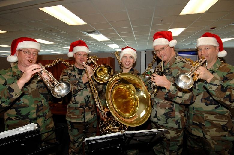 Members of the Band of the Golden West from Travis AFB toured Los Angeles AFB to spread holiday cheer to base personnel, Dec. 12. Pictured from left to right are: Tech Sgt. Jim Masters, Staff Sgt. Scott Ruedger, Master Sgt. Mike Goetz, Tech Sgt. Tom Hanrahau and Staff Sgt. Ed Schubert. (Photo by Lou Hernandez)