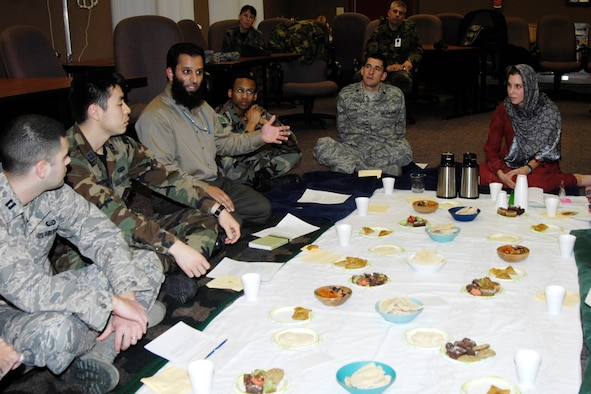 HANSCOM AFB, Mass. -- Mohammad Yaqub, 850th Electronic Systems Group, (third from left) shares information about Middle Eastern cultures during the Airman and Family Readiness Center-sponsored Culture Clash class Dec. 11. In addition to learning facts about Middle Eastern cultures, class attendees, some of whom will deploy soon, ate a Middle Eastern-style meal and were provided with country-specific handbooks and booklets with tips on interacting with people from different countries. Class facilitator 2nd Lt. Felisa Dyrud, 66th Mission Support Squadron, wore a hijab to the class to give class attendees a feel for the type of garb that is worn in some Middle Eastern countries. The lieutenant lived in Afghanistan for nine months before entering the Air Force. (U.S. Air Force photo by Linda LaBonte Britt)