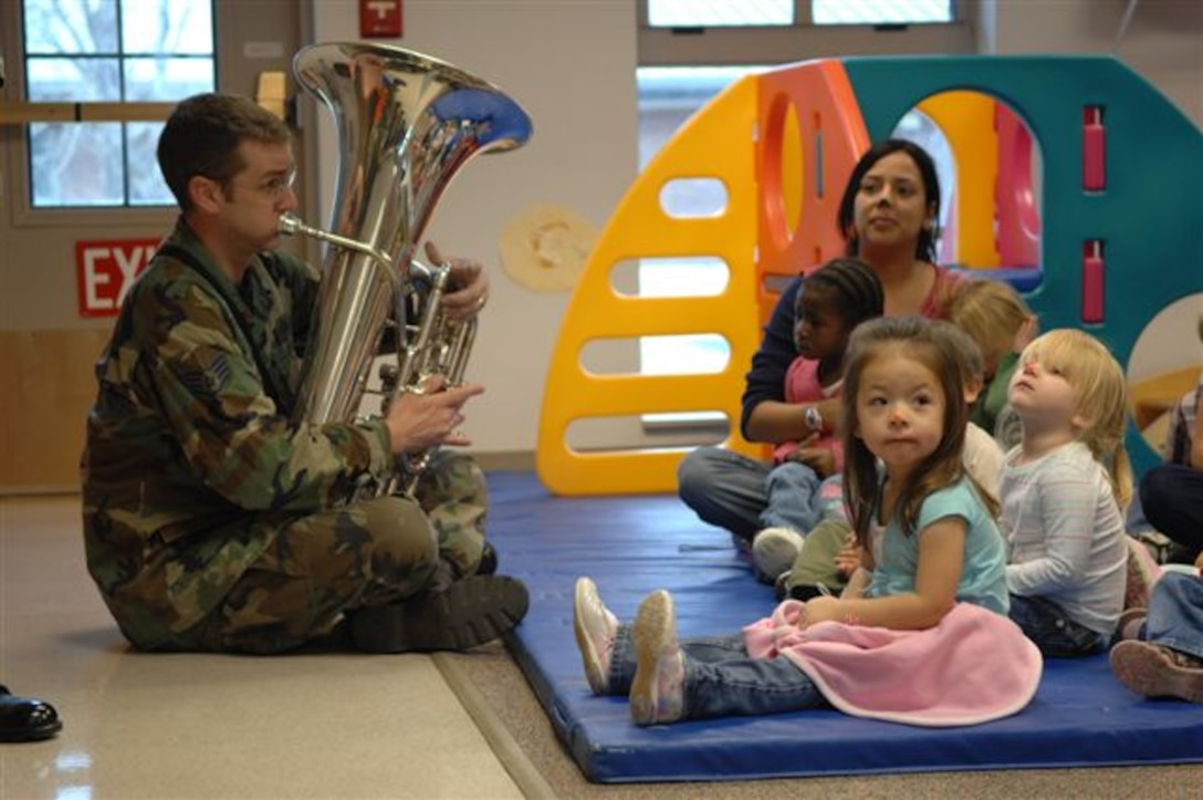 Staff Sgt. Mark Barnette gives children an up-close view of the tuba while the Offutt Brass performed at the Child Developement Center at Ellsworth Air Force Base.  Offutt Brass is one of seven ensembles from the USAF Heartland of America Band that divided up to visit six Air Force bases in the midwest sharing the holiday spirit with military members and their families.