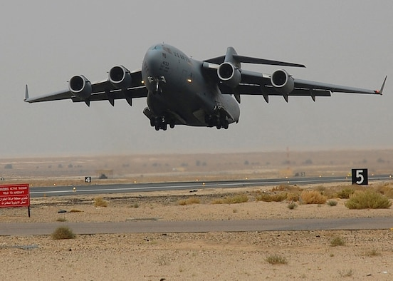 SOUTHWEST ASIA – An Air Force C-17 Globemaster III from McGuire AFB, N.J., takes off from an air base in Southwest Asia.  The C-17's primary mission in the AOR is to transport service members and cargo throughout the Middle East in support of Operations Enduring and Iraqi Freedom.  (U.S Air Force photo by Staff Sgt. Tia Schroeder)