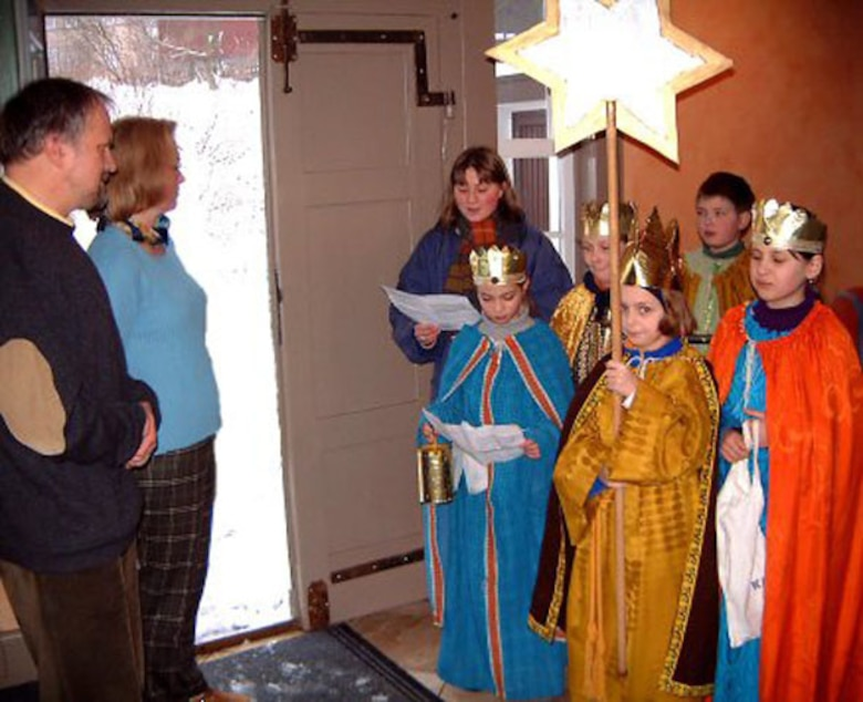 Children disguised as the Holy Three Kings go from house to house to collect donations for their church. Courtesy photo