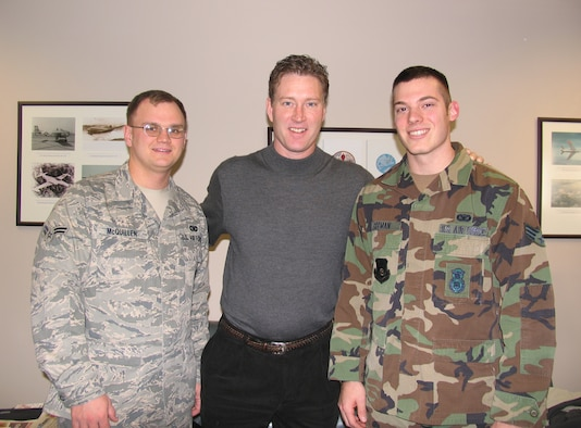 HANSCOM AFB, Mass. – Former Boston Bruins player Bob Sweeney (center) visited Hanscom on Dec. 11 to deliver tickets for an upcoming Boston Bruins game to Airmen honored at last week's Heroes' Homecoming celebration. Airman 1st Class Luke McQuillen (left), and Senior Airman Douglas Freeman (right), both from the 66th Security Forces Squadron had an opportunity to meet Mr. Sweeney during his base visit.(U.S. Air Force photo by 2nd Lt. Michaela Walrond)