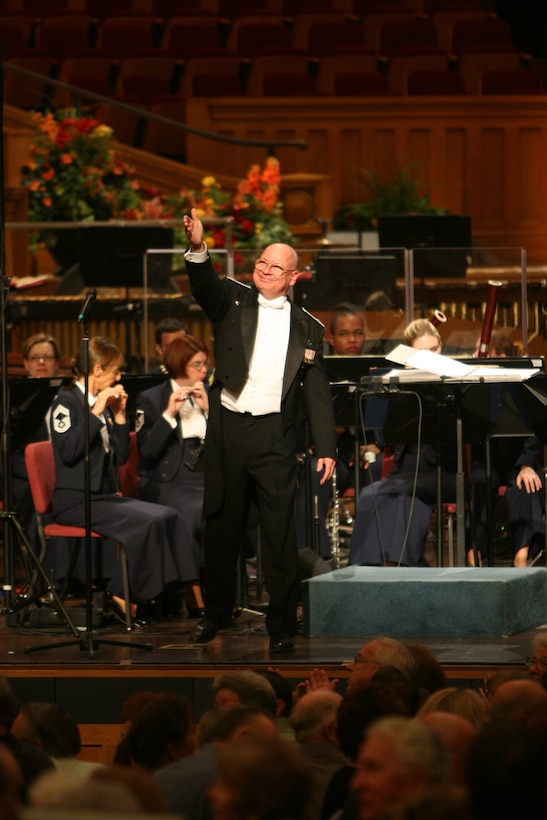 Colonel Dennis M Layendecker, Commander and Music Director of the United States Air Force Band, acknowledges the audience during a concert at the Mormon Tabernacle in Salt Lake City, Utah. (U.S. Air Force photo by SMSgt Robert Mesite)