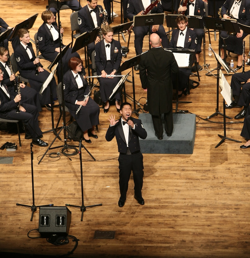 Technical Sgt Benjamin Park performs a solo with the United States Air Force Band at Weber State University in Ogden, Utah. Technical Sgt Park is a member of the Singing Sergeants, the official chorus of the United States Air Force.  (U.S. Air Force photo by SMSgt Robert Mesite)
