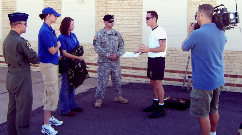 MCCONNELL AIR FORCE BASE, Kan. – A member of a local media organization interviews military members before being allowed to accompany a Golden Knights demonstration flight at the 2007 McConnell Open House. Some of Public Affairs responsibilities include escorting, facilitating and containing local media. (photo by Army Capt. Marcos Cervantes)