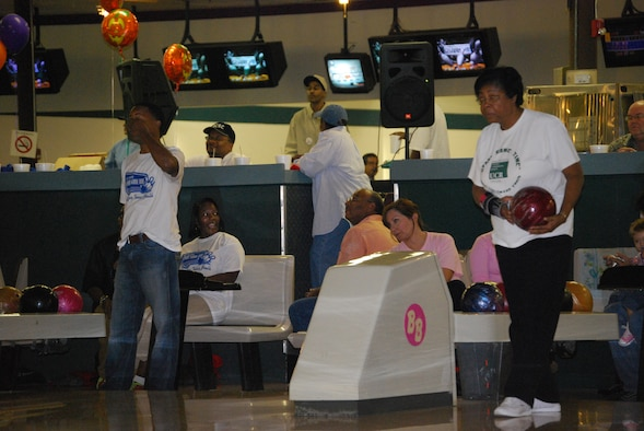 Chief Master Sgt. Laverne Vick (right), from LRS, sizes up the pins before scoring a Strike.  Mentors, like Chief Vick, are needed and serve as role models for TYC youths who are rejoining thier local community