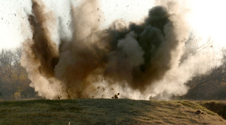 MCCONNELL AIR FORCE BASE, Kan. -- Explosive ordinance is detonated behind the Combat Arms Range on Nov. 19.  C-4 caused the detonation of the ordinance which is a common variety of military plastic explosive.  (Photo by Airman 1st Class Roy Lynch III)