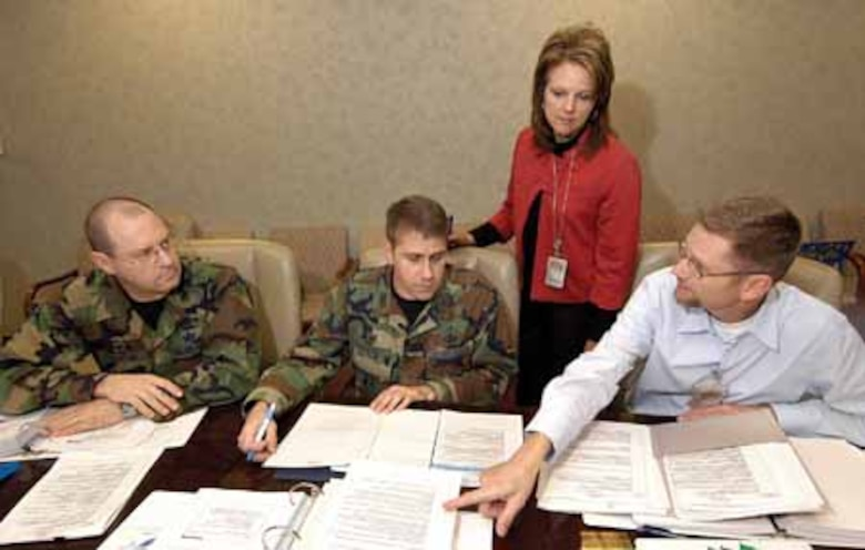 During a recent Green Belt class breakout session, members discuss their project to standardize the process and reduce the time required for organizational change request packages. From left are; Col. Michael Pelletier, 555th Aircraft Sustainment Squadron commander; Col. James Fulton, 727th Aircraft Sustainment Group commander;  DeLana Aylor, 448th Combat Sustainment Wing/Financial Management; and Ernie Guttery, 76th Maintenance Support Group.