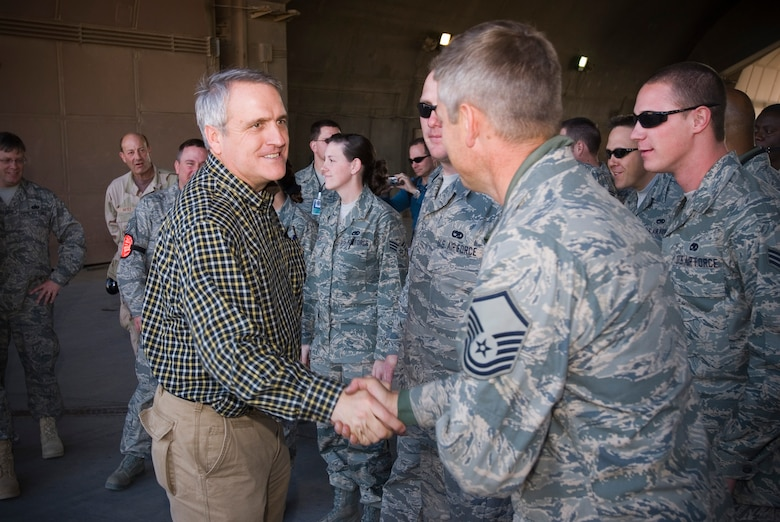 BALAD AIR BASE, Iraq -- Colorado Gov. Bill Ritter meets and greets Airmen of the 332nd Expeditionary Fighter Squadron from his state here, Dec. 12. The Governor is traveling through the area of responsibility visiting deployed Colorado Guardsmen. (U.S. Air Force photo/Master Sgt. John Nimmo, Sr.)