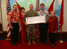 Honolulu Council Navy League staff came to present the a $6,000 check to Lt. Gen. John F. Goodman, commander, U.S. Marine Corps Forces Pacific on behalf of Toys for Tots, Dec. 14. From left to right: Bob McDermott, executive director, Carole Hickerson, golf committee lead, Lt. Gen. John F. Goodman, commander, U.S. Marine Corps Forces Pacific, Jack Flanagan, president, P. Pasha Baker, former president.
