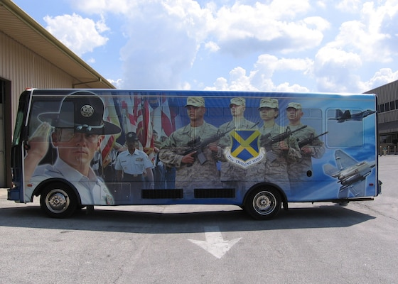 A bus used mostly for distinguished visitor tours on Lackland Air Force Base sports a shrink-wrapped picture of a military training instructor leading a group of trainees. The process of decorating a bus with a shrink-wrapped photo can take up to two weeks, depending on the design.