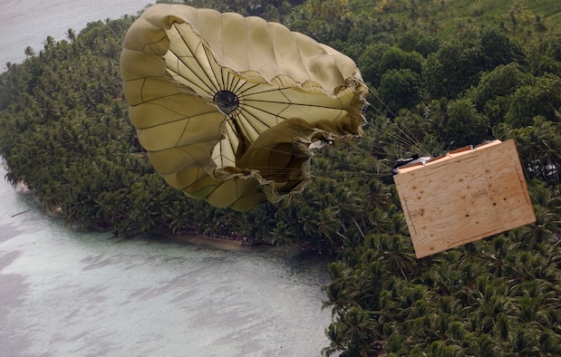 A pallet containing toys, holiday decorations and other donated items floats toward an island of the Western Pacific and Micronesia area, bringing holiday cheer Dec. 14 during Operation Christmas Drop. While Santa Claus must find a rooftop to land his reindeer on, America's Airmen and their four-propeller C-130 Hercules deliver the holiday items from the air and move on to their next target. (U.S. Air Force photo/Senior Airman Brian Kimball)