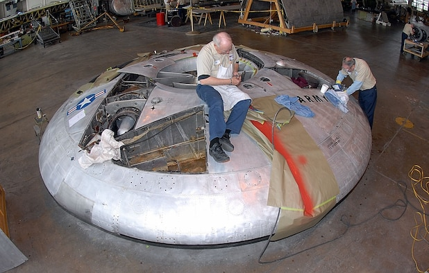DAYTON, Ohio (12/2007) -- Volunteers Ed Keinle and Lou Thole remove rivets from the Avrocar in the restoration hangar at the National Museum of the United States Air Force. (U.S. Air Force photo)