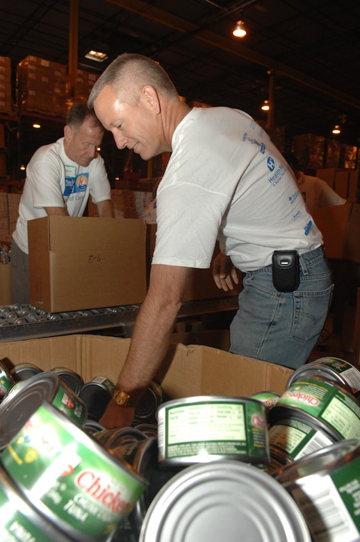 Chief Master Sgt. Wade Johnson of 12th Air Force Southern Command, sorts cans out of the box to place them in food care packages on Oct. 3 at Tucson Community Food Bank during the United Way Day of Caring. Sergeant Johnson was a participant in Davis-Monthan Air Force Base Airmen giving back to the community by helping to packing boxes during one of many different community involvement projects.  (US Photo By: SrA Jacqueline Hawkins)