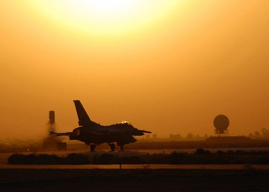 An Air Force F-16 Fighting Falcon takes off from Balad Air Base, Iraq, for a combat mission.  F-16s fly missions in support of Operation Iraqi Freedom.  (U.S. Air Force photo/Tech. Sgt. Beth Holliker)