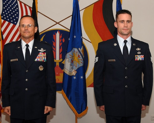Staff Sgt. Tom Pilla, 86th Construction and Training Squadron Explosive Ordnance Disposal instructor and Bronze Star recipient (right), stands at attention alongside Brig. Gen. Rich Johnston 86th Airlift Wing commander, during a Bronze Star award ceremony Dec. 13 at Ramstein Air Base, Germany. Sergeant Pilla was awarded the Bronze Star medal for meritorious conduct during operations in Iraq.  (U.S. Air Force photo/Airman 1st Class Kenny Holston)