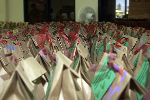 "More than 800 goodie bags were packed by volunteers during the Cookie Caper event held Dec. 17. The purpose Cookie Caper is to bring a ""taste of home"" to Andersen Airmen away from their families during the holidays. (U.S. Air Force photo/Airman 1st Class Carissa Morgan)"