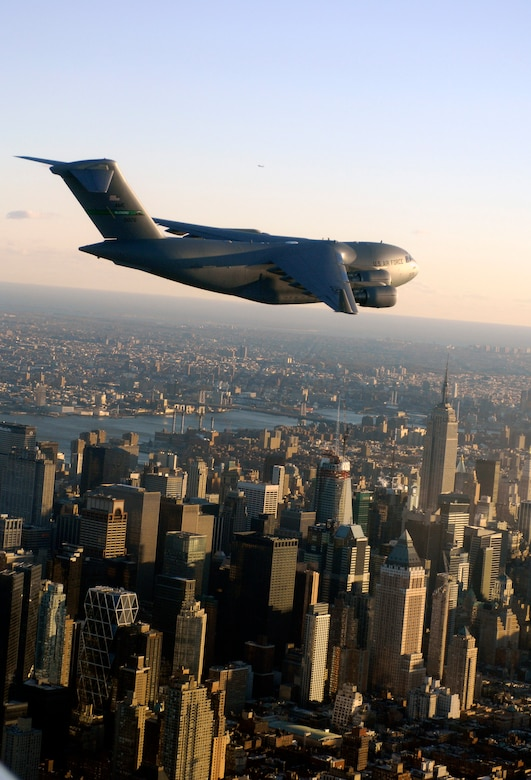 A C-17 Globemaster III flies over New York City after completing the first transcontinental flight on synthetic fuel Dec. 17. The C-17 took off before dawn from McChord Air Force Base, Wash., and landed in the early afternoon at McGuire AFB, N.J. (U.S. Air Force)