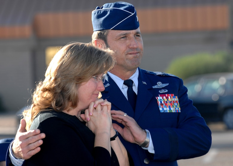 Brig. Gen. Tom Jones, 56th Fighter Wing commander, comforts Lisa Gillespie, wife of Master Sgt. Randy Gillespie, after the street sign revealing the newly-named Gillespie Drive was unveiled Dec. 18. Sergeant Gillespie was killed in action July 9, 2007. (photo by Tech. Sgt. Raheem Moore)