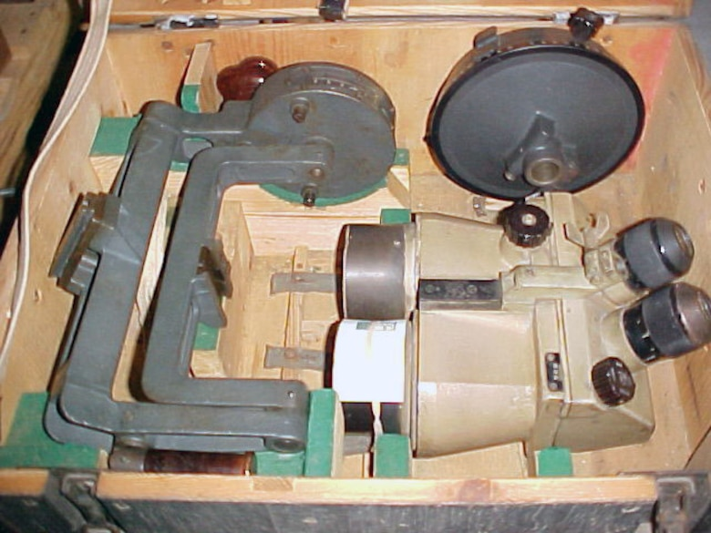 These anti-aircraft artillery binoculars with eyepad had a counting base, a connecting cord for night reticule illumination, and a finding sight. A tripod is also included. (U.S. Air Force photo)