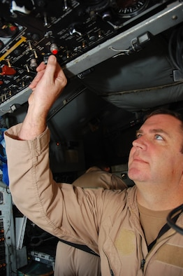 SOUTHWEST ASIA -- Master Sgt. Anthony Roy conducts a preflight inspection on an EC-130H Compass Call aircraft Dec. 8 here.  Sergeant Roy is an instructor flight engineer with the 43rd Expeditionary Electronic Combat Squadron and is deployed from Davis-Monthan AFB., Ariz.  (U.S. Air Force photo/Staff Sgt. Tia Schroeder)