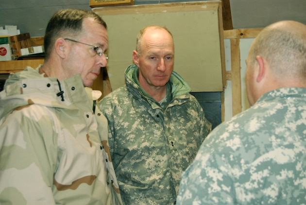 Adm. Mike Mullen (left), the chairman of the Joint Chiefs of Staff, gathers in discussion with Army Maj. Gen. Robert W. Cone (center), Combined Security Transition Command – Afghanistan commander, and Army Brig. Gen. Robert J. Livingston Jr., Combined Joint Task Force Phoenix VI commander just prior to the USO show at Camp Phoenix, Kabul, Afghanistan, Dec. 20. Photo by Marine Staff Sgt. Luis P. Valdespino Jr.