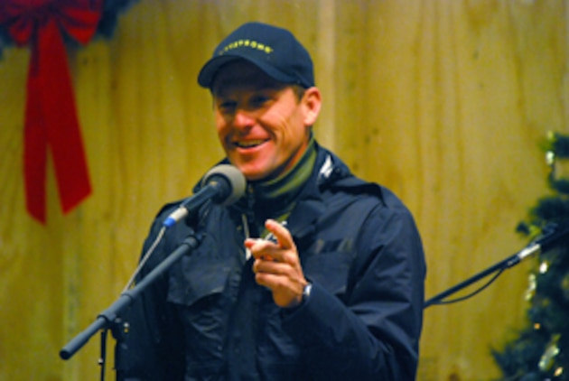 Lance Armstrong, seven-time Tour de France champion, speaks to military men and women as part of a USO show at Camp Phoenix, Kabul, Afghanistan, Dec. 20. Photo by Marine Staff Sgt. Luis P. Valdespino Jr.