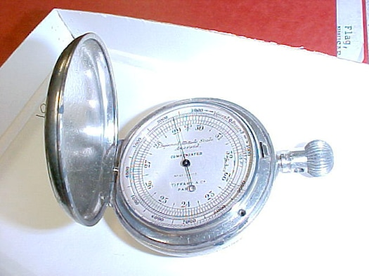 """This altimeter indicator belonged to the donor's uncle, William Thaw, who flew with the Lafayette Escadrille. The item reads """"Improved Altitude Scale Aneroid, Compensated."""" (U.S. Air Force photo)"""