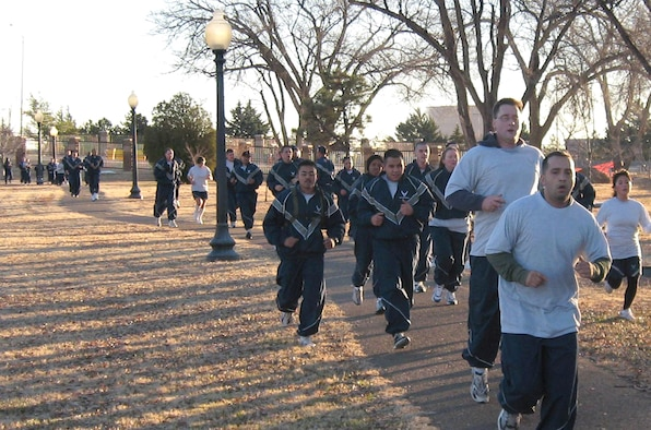 CANNON AIR FORCE BASE, N.M. -- Airmen head for the finish line during the Wingman 5K run Dec. 19. Base officials estimate that more than 900 runners participated in the event. (Courtesy photo)