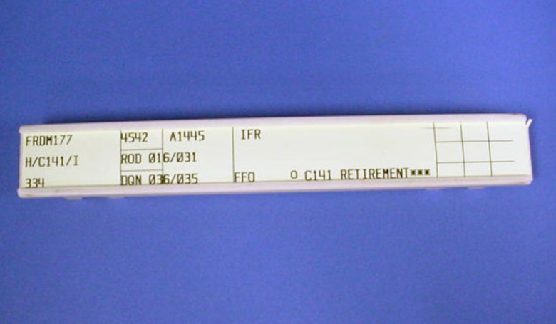 "The donor of this air traffic control tape strip was the co-pilot during the final flight of the C-141 ""Hanoi Taxi"" (S/N 66-0177) to the National Museum of the United States Air Force in May 2006. (U.S. Air Force photo)"