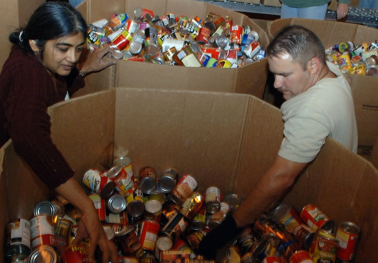 Sudha Brown (left) and Master Sgt. David Maxwell, along with 43 other Airmen and civilians from 12th Air Force headquarters, volunteered their time Saturday to provide service to more than 10,000 Tucson residents in need in the local community.  The team, who schedules time each quarter for group volunteer projects, volunteered at the Tucson Community Food Bank, a local charity striving to reduce the impact of hunger and chronic malnutrition through programs of advocacy and nutrition education.