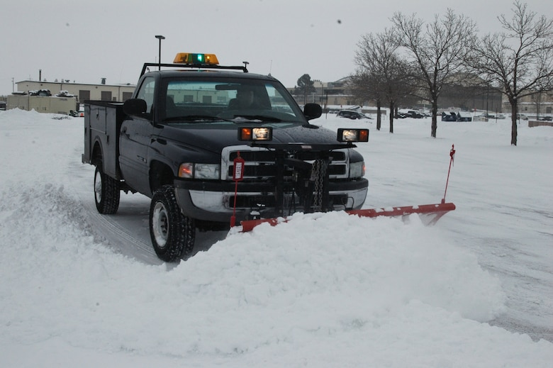Mr. Tom Sorrell, from the 140th Civil Engineer Squadron, pushes snow to the sides of the parking lot at the 140th Wing headquarters building at Buckley Air Force Base Dec. 27. (U.S. Air Force photo by Capt. Adrianne Michele)