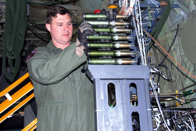 Tech. Sgt. Ben Filek practices loading a 30 mm Bushmaster cannon aboard an AC-130U Spooky gunship Jan. 26 at Hurlburt Field, Fla. The 30 mm gun will eventually replace both the 40 mm cannon and 25 mm gun on U-model gunships. Sergeant Filek is an aerial gunner with the 19th Special Operations Squadron at Hurlburt Field. (U.S. Air Force photo/Chief Master Sgt. Gary Emery)
