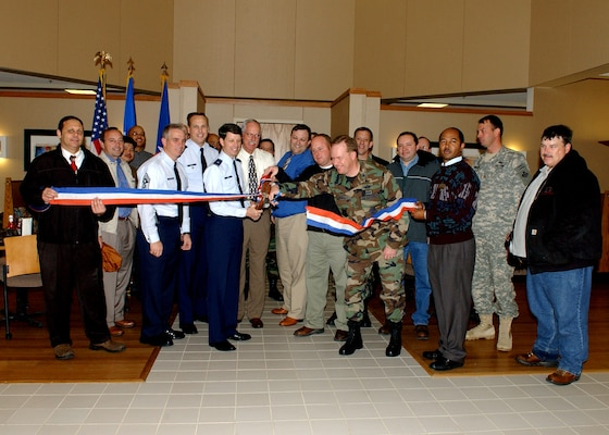 37th Training Wing and Services Division leadership, lead by Brig. Gen. Darrell Jones, then the 37th TRW commander, gather for the ceremonial ribbon cutting Jan. 24, 2007, at the new dining facility on the Lackland Training Annex at Lackland Air Force Base, Texas. (USAF photo by Alan Boedeker)