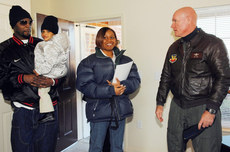Col. Joe Callahan, 23rd Wing commander, shows Staff Sgt. Jessica Davis, 347th Operations Support Squadron, and her husband Calvin, their new base housing unit.  The 2,100 square-foot home is the first of 383 units to be built in Moody's Magnolia Grove Housing area between now and December 2007. (U.S. Air Force photo by Airman 1st Class Gina Chiaverotti)