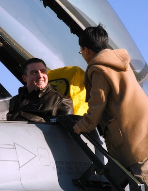 KUNSAN AIR BASE, Republic of Korea Jan. 19, 2007 -- First Lt. Brian Moore, 35th Fighter Squadron ?Panton? F-16 pilot, gives a local Korean student an up-close look at the flight controls of his fighter. More than 50 of the English students visited the base Jan. 19 to get a look at some of the Wolf Pack?s missions, sharper their English-speaking skills and learn how to use American currency.