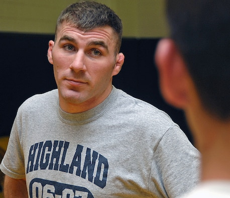 Stoks leads a practice session at Highland High School in Albuquerque. Airman Stoks has used his past experience as an All-American college wrestler to help coach the high school?s wrestling team. (U.S. Air Force photo by Todd Berenger)