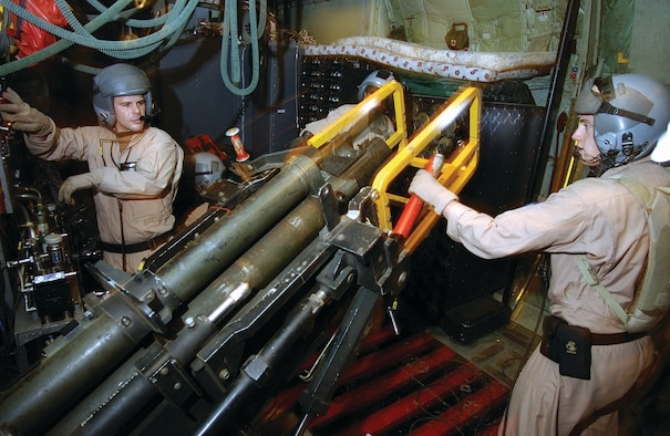 Aerial gunners with the 4th Special Operations Squadron load the 105 mm Howitzer cannon on an AC-130U Spooky gunship. In addition to the cannon, four of the squadron's AC-130U models will also be equipped with two 30 mm guns.  (Courtesy photograph)