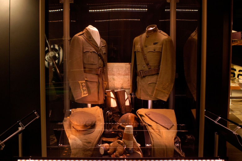 DAYTON, Ohio - (Left) British Royal Flying Corp cap, tunic, trousers and flying equipment worn by Capt. William C. Lambert during World War I. The bar decoration below the RFC wings on the tunic was the ribbon design for the original British Distinguished Flying Cross. (Right) Uniform items worn by Lt. Stephen W. Thompson on Feb. 5, 1918, when, while flying as an observer with the French, he became the first person in U.S. uniform to down an enemy airplane. (U.S. Air Force photo)