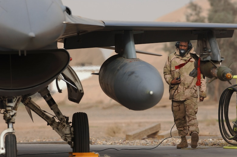 Senior Airman Robert Gattison communicates with the pilot of this F-16 Fighting Falcon Jan. 29 during a pre-flight check at Balad Air Base, Iraq, before the aircraft takes off on a combat mission.  Airman Gattison is a crew chief with the 14th Expeditionary Aircraft Maintenance Squadron.  (U. S. Air Force photo/Staff Sgt. Michael R. Holzworth)