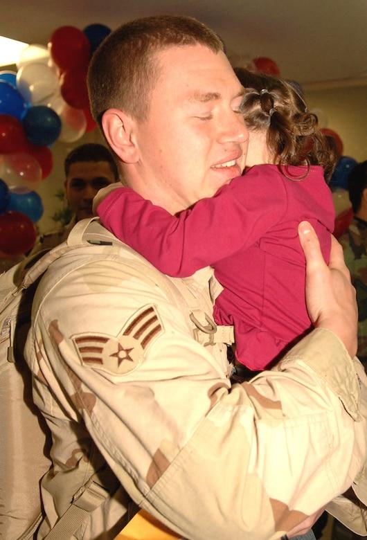 YOKOTA AIR BASE, Japan -- Senior Airman Josh Joslyn, 374th Logistic Readiness Squadron, reunites with his daughter Jasmine Joslyn after his deployment supporting Operation Iraqi Freedom. (U.S. Air Force photo by SrA Veronica Pierce)