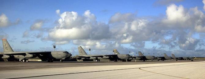 ANDERSEN AIR FORCE BASE, Guam –  A row of B-52 Stratofortresses from Barksdale Air Force Base, La. and Minot AFB, N.D. await their next mission on the flightline at Andersen AFB, Guam.  The different colored tail markings represent the individual squadrons each bomber is assigned to at their home station.  Approximately 300 Airmen from Barksdale AFB, La. arrived on Guam this week as part of a scheduled rotation of bomber units into the Pacific theatre.  (U.S. Air Force Photo by Senior Master Sgt. Don Perrien)