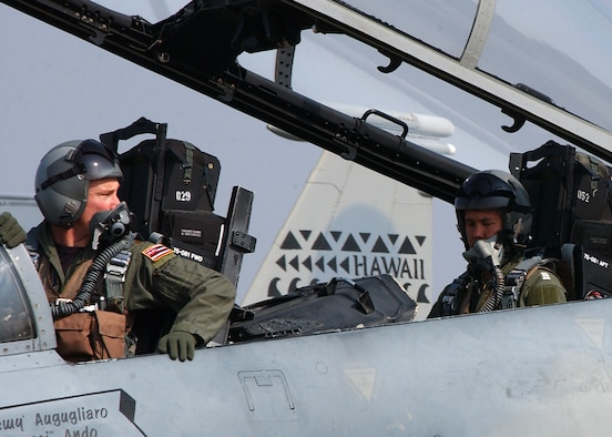 Maj. Brian Kilty, F-15 pilot with the Hawaii Air National Guard's 199th Fighter Squadron, Hickam Air Force Base, Hawaii, takes Wing Commander Napassdol Pavarabaddhanaguna, an F-16 pilot with the 103 Squadron, Royal Thai Air Force on an Orientation flight during the Cope Tiger 2007 Exercise in Korat, Thailand.  Cope Tiger is a multilateral combined air exercise involving the U.S., Thailand and Singapore.  The familiarization flight provides a quality venue to develop multilateral interoperability and demonstrates coalition procedures for air power missions. (USAF photo by Master Sgt. Kristen Higgins)