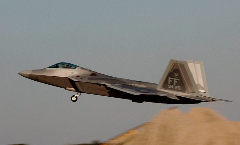 Lt. Col. Dirk Smith takes flight in an F-22 Raptor Feb. 3 at Langley Air Force Base in Virginia.The 94th Fighter Squadron is deploying for Red Flag at Nellis AFB, Nev. Red Flag is an air combat training exercise designed to test pilots and air support crews' ability to affectively respond to real-world combat scenarios. This is the first deployment to Red Flag for the 94th FS with F-22s. Colonel Smith is the 94th FS commander. (U.S. Air Force photo/Staff Sgt. Samuel Rogers)