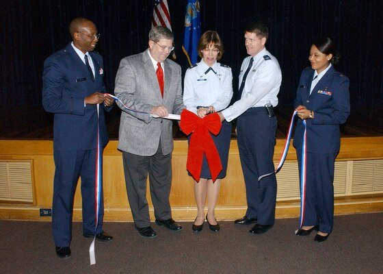 Capt. Radcliff Myers, Kenneth Williams, 59th Medical Support Group Commander Col. Kimberly Slawinski, 37th Training Wing Vice-commander Col. Eric Wilbur and Maj. Claudine Wega cut the ribbon Feb. 2 to officially commence the base's recognition of African-American History Month. The opening ceremony was conducted in the Wilford Hall Medical Center auditorium on Lackland Air Force Base, Texas. Chief Master Sgt. Candance Curtz, WHMC's manager of cardiopulmonary services, was the guest speaker. Other speakers included Maj. Claudine Wega, who spoke about Frederick Douglas, and 2nd Lt. David Herndon, who spoke about Hiram Rhodes Revels. (USAF photo by Alan Boedeker)